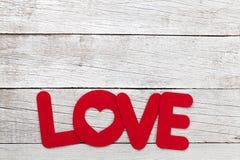 Carte de voeux de jour de valentines avec le mot d'amour image libre de droits