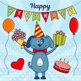 Carte de voeux de joyeux anniversaire Un chien de bande dessinée avec un cadeau et un bouquet des fleurs, des ballons, d'un coeur Image libre de droits