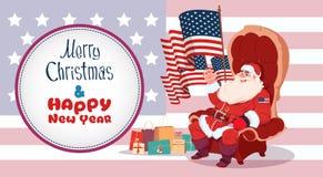 Carte de voeux de Joyeux Noël et de bonne année avec le concept de bannière de vacances d'hiver de Santa Claus Sitting Hold Usa F Image stock