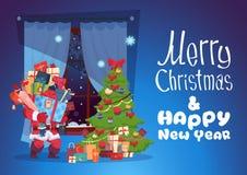 Carte de voeux de Joyeux Noël et de bonne année Santa Holding Gift Boxes Photo libre de droits