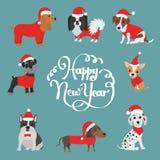 Carte de voeux pour 2018 An neuf heureux Chiens dans des costumes Santa Claus Image stock