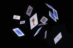 Carte della mazza di volo su fondo nero Fotografia Stock Libera da Diritti