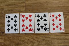 Carte della mazza su un backround di legno, sull'insieme dei dieci dei club, sui diamanti, sulle vanghe e sui cuori Fotografia Stock Libera da Diritti
