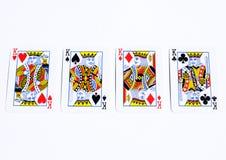 Carte della mazza sugli ambiti di provenienza bianchi Quattro re Immagine Stock