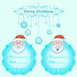 Carte di Santa Claus Gift Natale con la struttura d'annata e desideri di Natale nell'inverno inglese Fotografia Stock