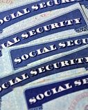Carte di sicurezza sociale che rappresentano pensionamento Fotografia Stock Libera da Diritti