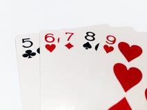 Carte droite en jeu de poker avec le fond blanc Photos stock