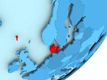 Carte du Danemark sur le globe politique bleu Photographie stock