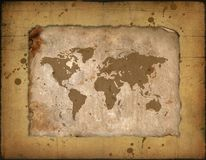 Carte du monde sur un roulis antique Photographie stock