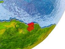 Carte du Surinam sur terre Image stock