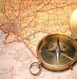Carte et compas Images libres de droits