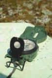 Carte et compas Photographie stock