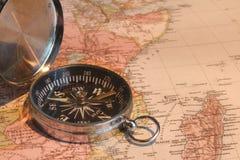 Carte et compas Photos libres de droits