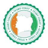 Carte et drapeau d'Ivoire de ` de Cote D en caoutchouc de vintage Image libre de droits