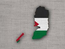 Carte et drapeau de la Palestine sur la vieille toile Image stock