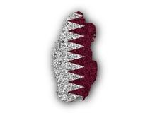 Carte et drapeau du Qatar sur des clous de girofle Photos libres de droits