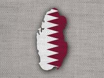 Carte et drapeau du Qatar sur la vieille toile Image stock