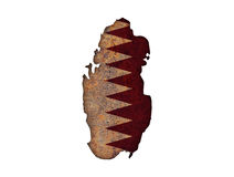 Carte et drapeau du Qatar sur le métal rouillé Photos stock
