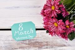 Carte et fleurs sur le bois Photo libre de droits