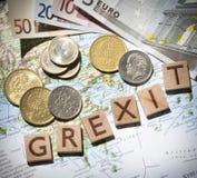 Carte, euros et lettres grecs de grexit de drachme d'en haut Photo stock