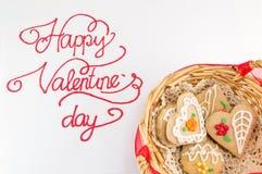 Carte heureuse de calligraphie de jour de valentines avec des biscuits Photo stock
