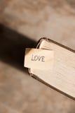 Carte heureuse de jour de valentines d'AMOUR Photos libres de droits