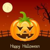 Carte heureuse de potiron de Halloween sur l'orange Images stock