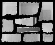 Carte lacerate sul nero Fotografie Stock Libere da Diritti