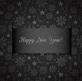 Carte noire de nouvelle année avec les étoiles, le soleil et la lune Photos stock