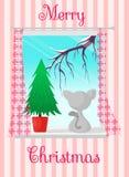 Carte postale avec une vue d'hiver Arbre de chat et de Noël dans la fenêtre Le Joyeux Noël d'inscription Image libre de droits