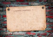 Carte postale on a brick wall Stock Photography