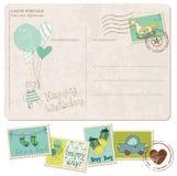 Carte postale d'arrivée de bébé avec l'ensemble d'estampilles Photographie stock