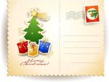 Carte postale de Noël avec l'arbre et les cadeaux Image stock