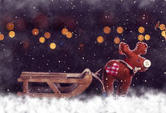 Carte postale de Noël Cerfs communs avec le traîneau vide Image libre de droits