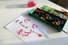 Carte postale mignonne avec la déclaration de l'amour dans la recherche calligraphique de style Images stock