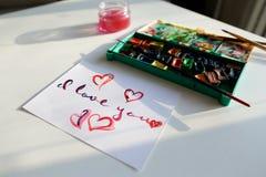 Carte postale mignonne avec la déclaration de l'amour dans la recherche calligraphique de style Image stock