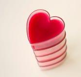 Carte romantique avec le coeur rouge Image stock