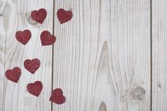 Carte rouge scintillée de coeurs du ` s de Valentine photographie stock libre de droits