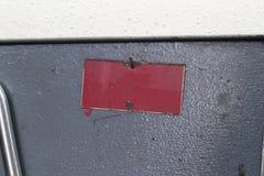 Carte rouge sur le lieu de travail Photo stock