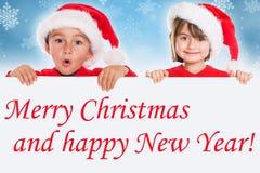 Carte Santa Claus d'enfants d'enfants de Joyeux Noël photographie stock