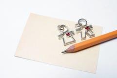 Carte vierge avec le crayon et le cadeau de l'amour Photo stock