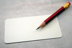 Carte vierge de visite avec le crayon Photographie stock