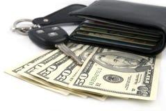 Carteira, chave e dinheiro Fotografia de Stock Royalty Free