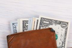 Carteira de couro com dinheiro dos dólares dos EUA Fotografia de Stock