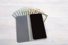 Carteira de couro com dinheiro dos dólares dos EUA Imagens de Stock Royalty Free