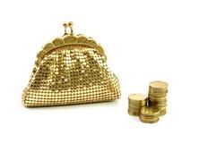Carteira e moedas douradas Imagens de Stock Royalty Free