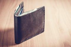 Carteira preta com dinheiro Foto de Stock Royalty Free