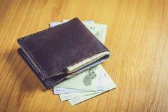 Carteira preta com dinheiro Imagem de Stock Royalty Free