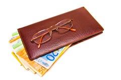 Carteiras e dinheiro Fotografia de Stock Royalty Free