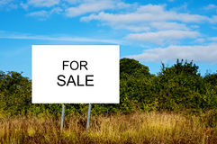 Cartel advertising. `For Sale`. Business of buying and selling land Royalty Free Stock Image